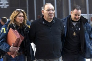 Thomas Di Fiore is escorted by FBI agents from their Manhattan offices in New York