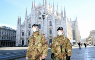 Italian Military officers wearing face masks outside Duomo cathedral, closed due to the coronavirus outbreak.