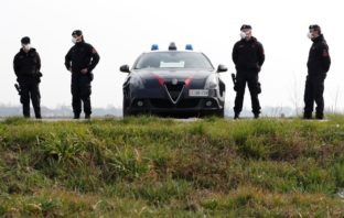 Carabinieri officers wearing face masks on patrol.