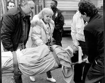 """Patricia Capozzalo, brother of Lucchese crime family member Peter """"Big Pete"""" Chiodo, being transported to an ambulance after being shot."""