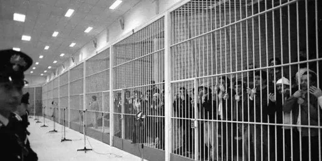 Cages along the back wall of the Maxi Trial courtroom.